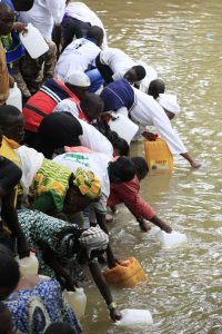 Worshippers of Osun goddess pray to the goddess and other spirits at the Osun river in Osogbo, Nigeria, Friday Aug. 23, 2013. Many of the worshippers observing the centuries-old ethnic Yoruba celebration in southwestern Nigeria are Christians and Muslims. (AP Photo/Sunday Alamba)