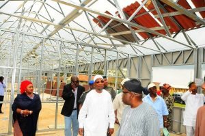 Governor State of Osun, Ogbeni Rauf Aregbesola (Middle); Chairman, O-Schools in the State, Hon. Lai Oyeduntan (3rd right in glasses); Special Adviser to the Governor on Federal Matters, Mrs Yidiat Babalola; Director, Bureau of Communications and Strategy, Mr Semiu Okanlawon (2nd left) and others, during the Governors impromptu visit to the on-going fabricated school building at Saint Stephens Elementary Model School, Ode-Omu, State of Osun on Thursday