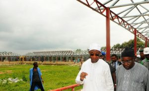 Governor State of Osun, Ogbeni Rauf Aregbesola, walking and talking about the construction works to the Chairman, O-School in the State, Hon. Lai Oyeduntan, during his impromptu visit to the on-going fabricated school building at Saint Stephens Elementary Model School, Ode-Omu, State of Osun on Thursday