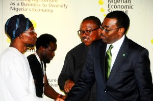 Governor State of Osun , Ogbeni Rauf Aregbesola in hand-Shake with Minister for Agriculture , Dr. Akinwumi Adesina and Anambra State Governor, Mr. Peter Obi  during the 19th Nigerian Economic Summit, at Transcorp Hilton Abuja, on Wednesday 04 – 09 – 2013 .