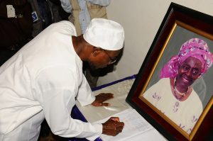 State of Osun Governor, Ogbeni Rauf Aregbesola writing condolence message during a visit the family of the first female Head of Service, late (Mrs) Tejumade Alakija in Ibadan last week Thursday