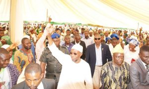 Governor State of Osun, Ogbeni Rauf Aregbesola, acknowledging cheers from the crowd during the a public assessment, tagged- Gbangbadekun, held at Baptist Primary School, Ila-Orangun on Tuesday 03-09-2013