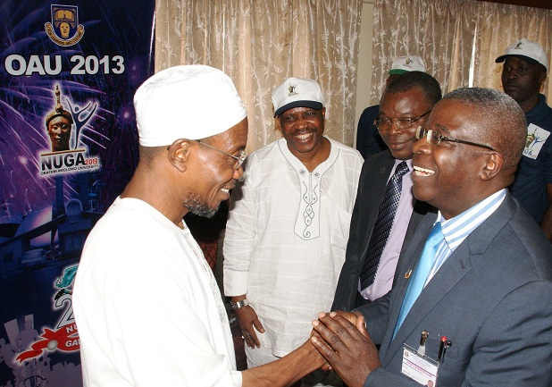 From left, Governor State of osun, Ogbeni Rauf Aregbesola; OAU 2013 Nigeria University Game Mascut and Vice Chancellor, Obafemi Awolowo University (OAU) Ile-Ife, Professor Bamitale Omole, at the unveiling ceremony of the Mascot for OAU 2013 Nigeria University Game by the governor in his office, Abere, Osogbo, State of Osun on Monday 09-09-2013