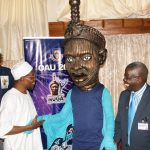 From left, Governor State of osun, Ogbeni Rauf Aregbesola; OAU 2013 Nigeria University Game Mascot and Vice Chancellor, Obafemi Awolowo University (OAU) Ile-Ife, Professor Bamitale Omole, at the unveiling ceremony of the Mascut for OAU 2013 Nigeria University Game by the governor in his office, Abere, Osogbo, State of Osun on Monday 09-09-2013