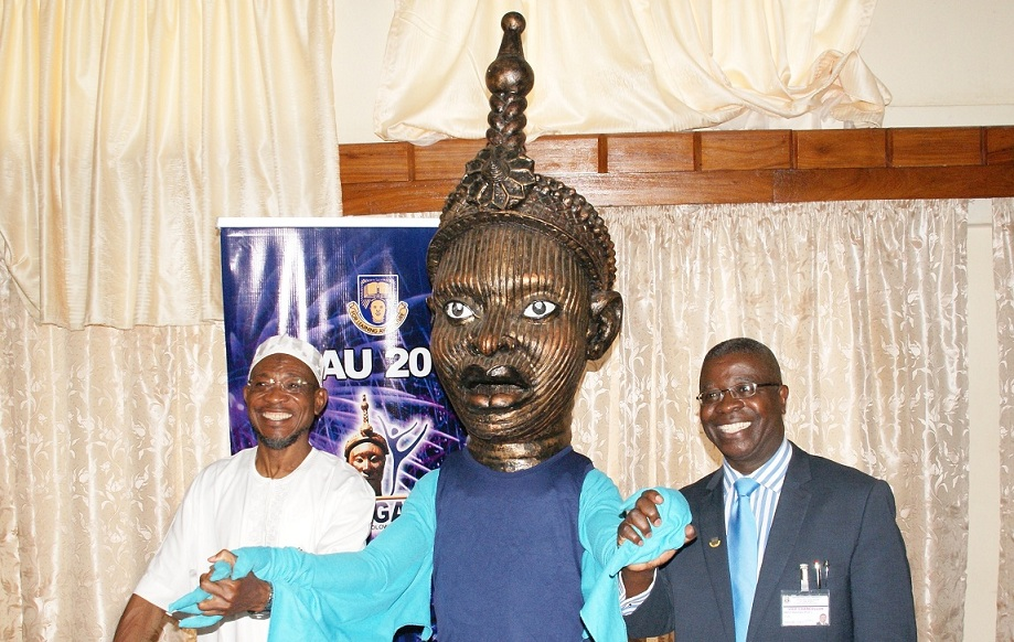 Froml right, Vice Chancellor, Obafemi Awolowo University (OAU) Ile-Ife, Professor Bamitale Omole; OAU 2013 Nigeria University Game Mascot; Governor State of Osun, Ogbeni Rauf Aregbesola and a popular comedian Boy Alinco, at the unveiling ceremony of the Mascut for OAU 2013 Nigeria University Game by the governor in his office, Abere, Osogbo, State of Osun on Monday 09-09-2013