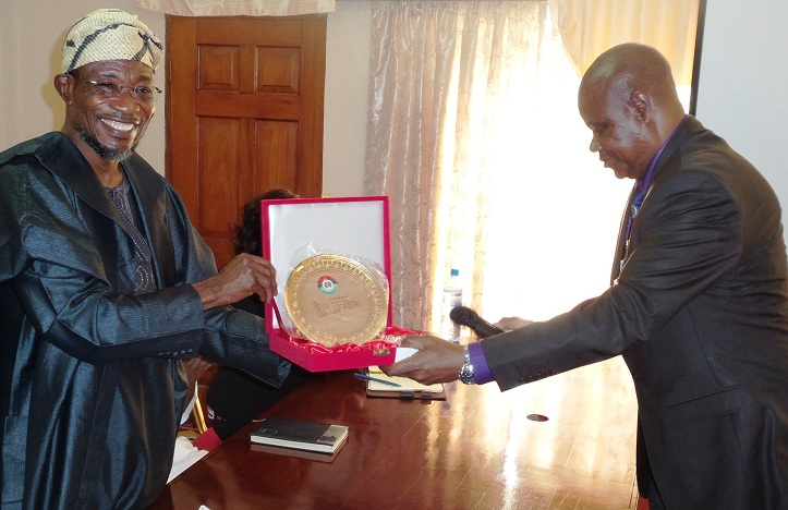 Governor State of Osun,Ogbeni Rauf Aregbesola ( left), receiving a gift from the CoordinatingTeam Leaderof the course 22 participants of the National Defense College, Abuja, Brig.Gen. Alani Okunola, during their visit to the governor in his office on assessment of the State of Osun, Abere, Osogbo, the State Capital last week