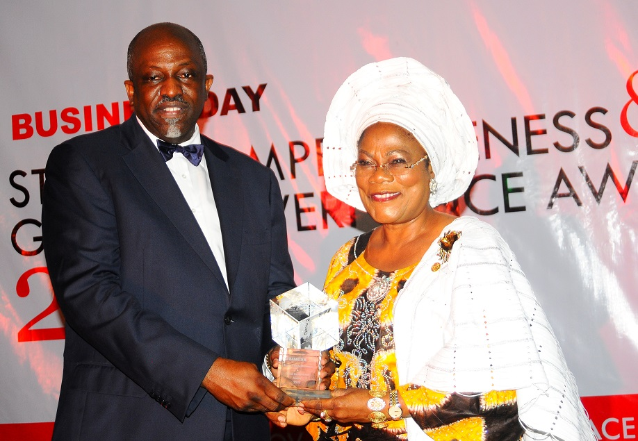 Deputy Governor State of Osun, Mrs Titi Laoye-Tomori representing the Governor receiving an award as the Best Governor in Urban and Rural Development from Managing Director Maevis, Mr Tunde Fagbemi, during the Businessday States Competitiveness and Good Governance Awards 2013, at Federal Palace Hotel Victoria Island, Lagos State on Wednesday 13-11-2013