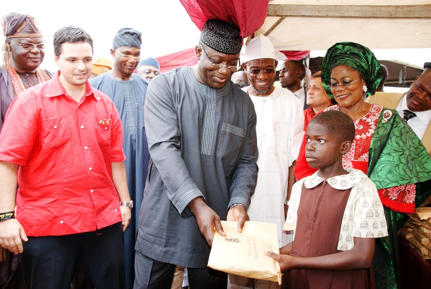 From left, Minister Counselor, Embassy of the Bolivarian Republic of Venezuela, Miguelangel Vecchia; Ekiti State Governor, Dr Kayode Fayemi; Governor State of Osun, Ogbeni Rauf Aregbesola; his Deputy, Mrs Titi Laoye-Tomori and others, at the Distribution of free Education Materials by the Venezuelan Ambassador in the Country to Students of Public Primary Schools in Osun, at Anthony Udofia Elementary School, Osogbo, State of Osun on Wednesday 27-11-2013