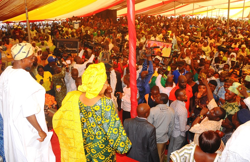 """Governor State of Osun, Ogbeni Rauf Aregbesola (left) and his Deputy, Mrs Titi Laoye-Tomori acknowledging cheers from the crowd, during the 5th edition of an interactive programme between the Public and the Governor, tagged, """"Gban-gba Dekun"""" in Boripe/Ifelodun and Odo-Otin Federal Constituency, at Akin-Orun Grammar School, Ikirun the State of Osun on Tuesday 19-11-2013"""