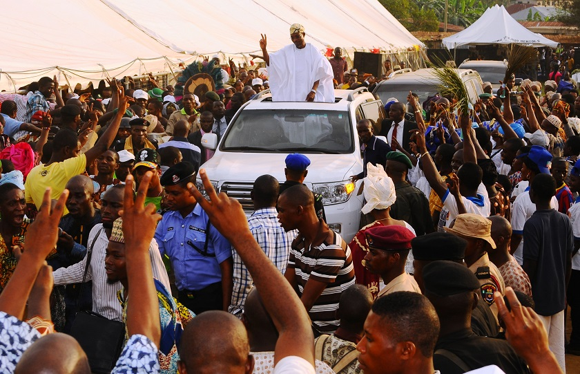 """Governor State of Osun, Ogbeni Rauf Aregbesola acknowledging cheers from the crowd after the 5th edition of an interactive programme between the Public and the Governor, tagged, """"Gban-gba Dekun"""" in Boripe/Ifelodun and Odo-Otin Federal Constituency, at Akin-Orun Grammar School, Ikirun the State of Osun on Tuesday 19-11-2013"""