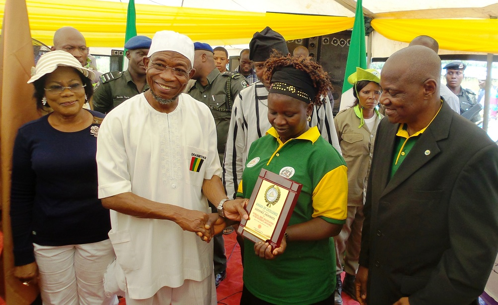 State of Osun Deputy Governor, Mrs Titi Laoye-Tomori; Governor Aregbesola; Commissioner for Agriculture, Dr Wale Adedoyin; Overall Best Graduating O-Yes Student in Livestock/Fishery,, Mrs Adenike Akinbote  and Group Managing Director, Odua Investment Company, Alhaji Adbayo Jimoh, during the inspection of farm produce, at the graduation ceremony of Osun-Odua Farmers Academy at Ede in the State of Osun on Thursday 28-11-2013