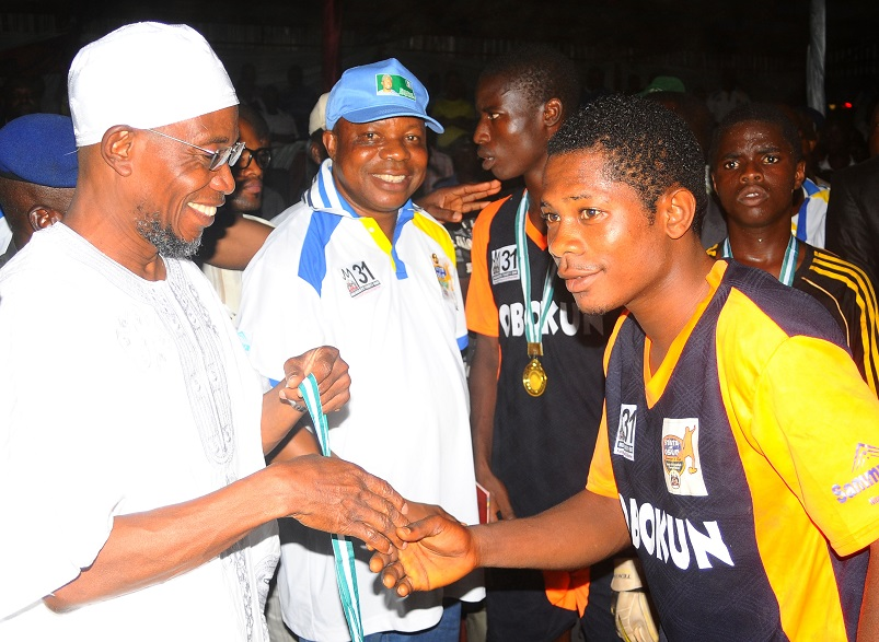 From left, Governor State of Osun, Ogbeni Rauf Aregbesola; Special Adviser to the Governor on Youth, Sports and Special needs, Comrade Biyi Odunlade; Member Obokun Local Government team, Tunde Anjorin and others, after winning the State of Osun Under-17 Governor's Cup, at technical college, Osogbo the State of Osun
