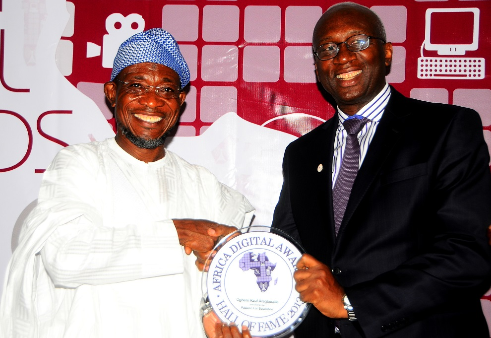 Professional Telecommunication Engineer, Corporate, Entrepreneur and Business Management Trainer, Engineer [Dr] Ernest Ndukwe (right) , during the induction of Governor Aregbesola into the Hall of Fame for Africa Digital Awards, at Sheraton hotel Lagos on Sunday 8/12/2013