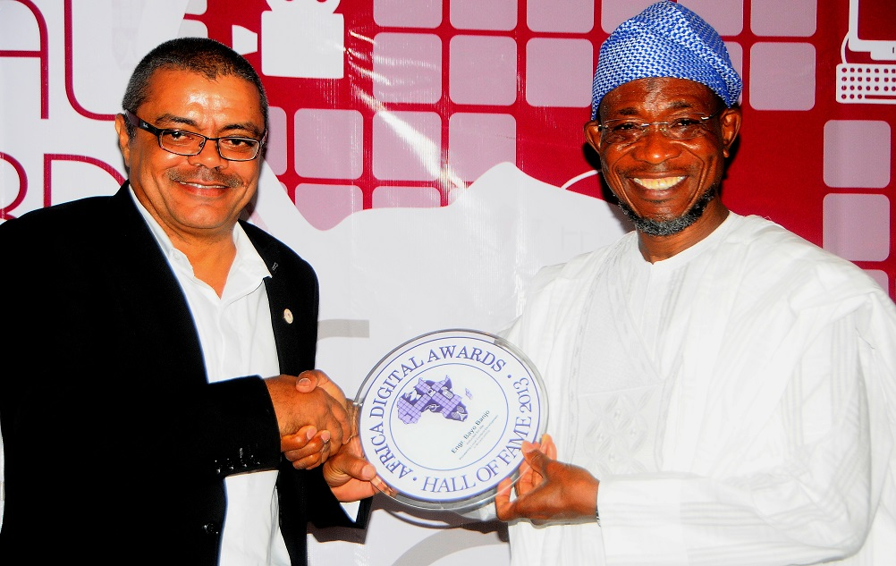 Governor State of Osun, Ogbeni Rauf Aregbesola presenting Award to the President of the Nigeria Internet Group [NIG] Engineer. Bayo Banjo, during the induction of Governor Aregbesola into the Hall of Fame for Africa Digital Awards, at Sheraton hotel Lagos on Sunday 8/12/2013