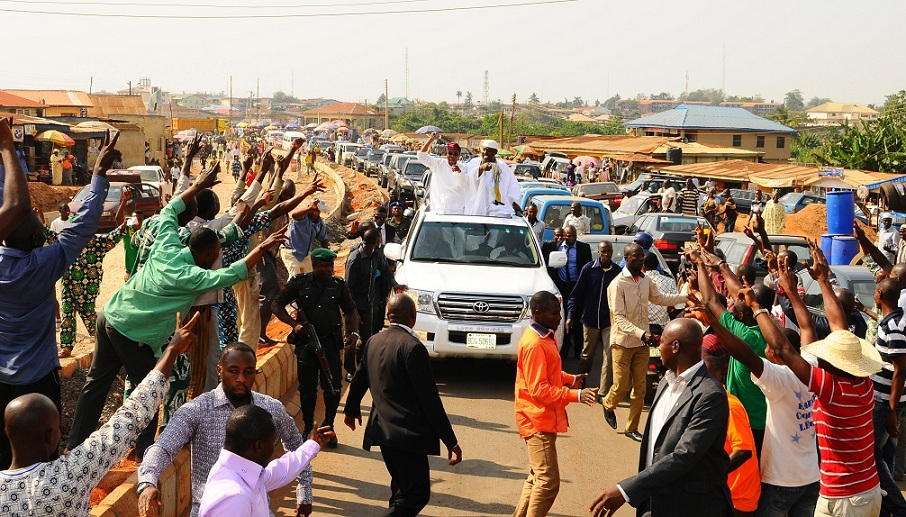 Governor State of Osun, Ogbeni Rauf Aregbesola and  his Imo State Counterpart, Governor Rochas Okorocha  acknowledging cheers from the All Progressive Congress Supporters in the State, during the Party's National Mobilisation Committee's Visit to the State at Osogbo City Stadium, Osogbo, State of Osun on Tuesday 10-12-2013