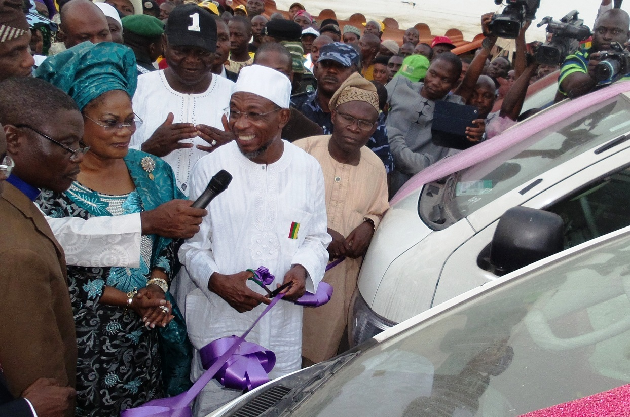 From left, Chairman, Christian Association of Nigeria (CAN), State of Osun, Reverend  Elijah Ogundiya; State of Osun Deputy Governor, Mrs Titi Laoye-Tomori; Governor Rauf Aregbesola; Commissioner for Commerce, Cooperative and Empowerment, Hon. Ismaila Jayeoba Alagbada  and others, during the Commissioning and Distribution of  70 Vehicles (18 sitter Toyota Commuter Bus) to members of the National Union of Road Transport Workers (NURTW) by the State Government, at the Governor's office, Abere, Osogbo, State of Osun on Monday 23-12-2013