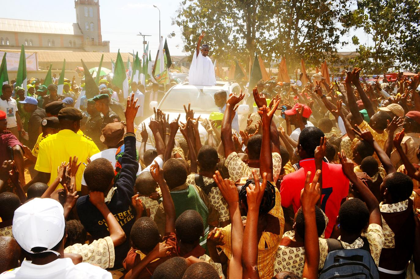 """Governor State of Osun, Ogbeni Rauf Aregbesola acknowledging cheers from  Ijesha people while rejoicing with prayer of supports for his Second Term in office  immediately after the 6th edition of an interactive programme tagged, """"Gban-gba Dekun"""" in Ijesha South Federal Constituency consisting of Ilesa West, Ilesa East, Atakumosa East and Atakumosa West Local Governments at Ilesa High School, Ilesa, State of Osun last week"""