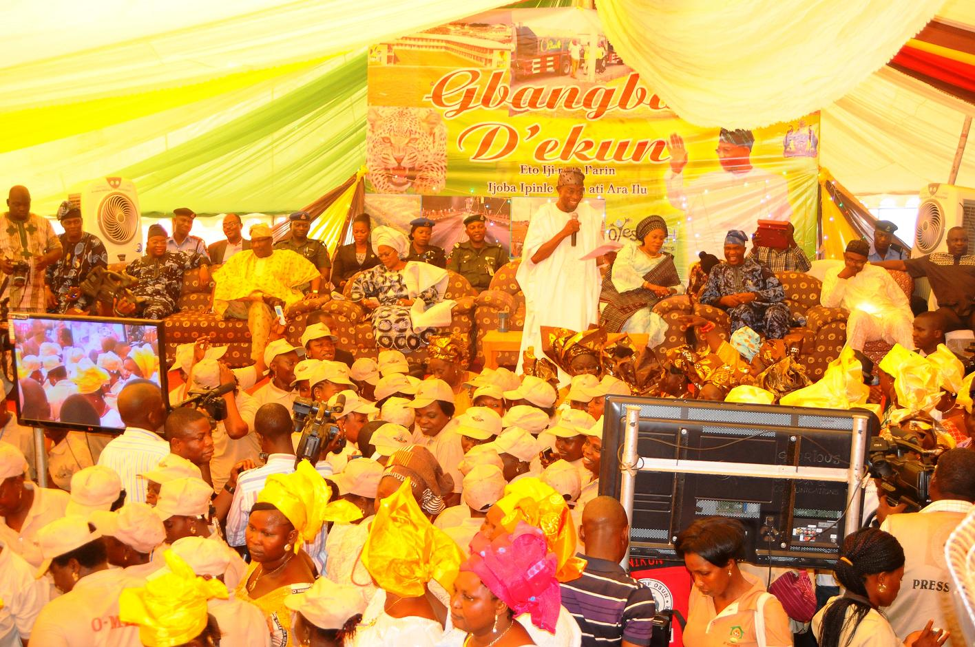 """Governor State of Osun, Ogbeni Rauf Aregbesola (standing) addressing the people of Ijeshaland after their word of support for his Second Term in office,  during the 6th edition of an interactive programme tagged, """"Gban-gba Dekun"""" in Ijesha South Federal Constituency consisting of Ilesa West, Ilesa East, Atakumosa East and Atakumosa West Local Governments at Ilesa High School, Ilesa, State of Osun last week"""