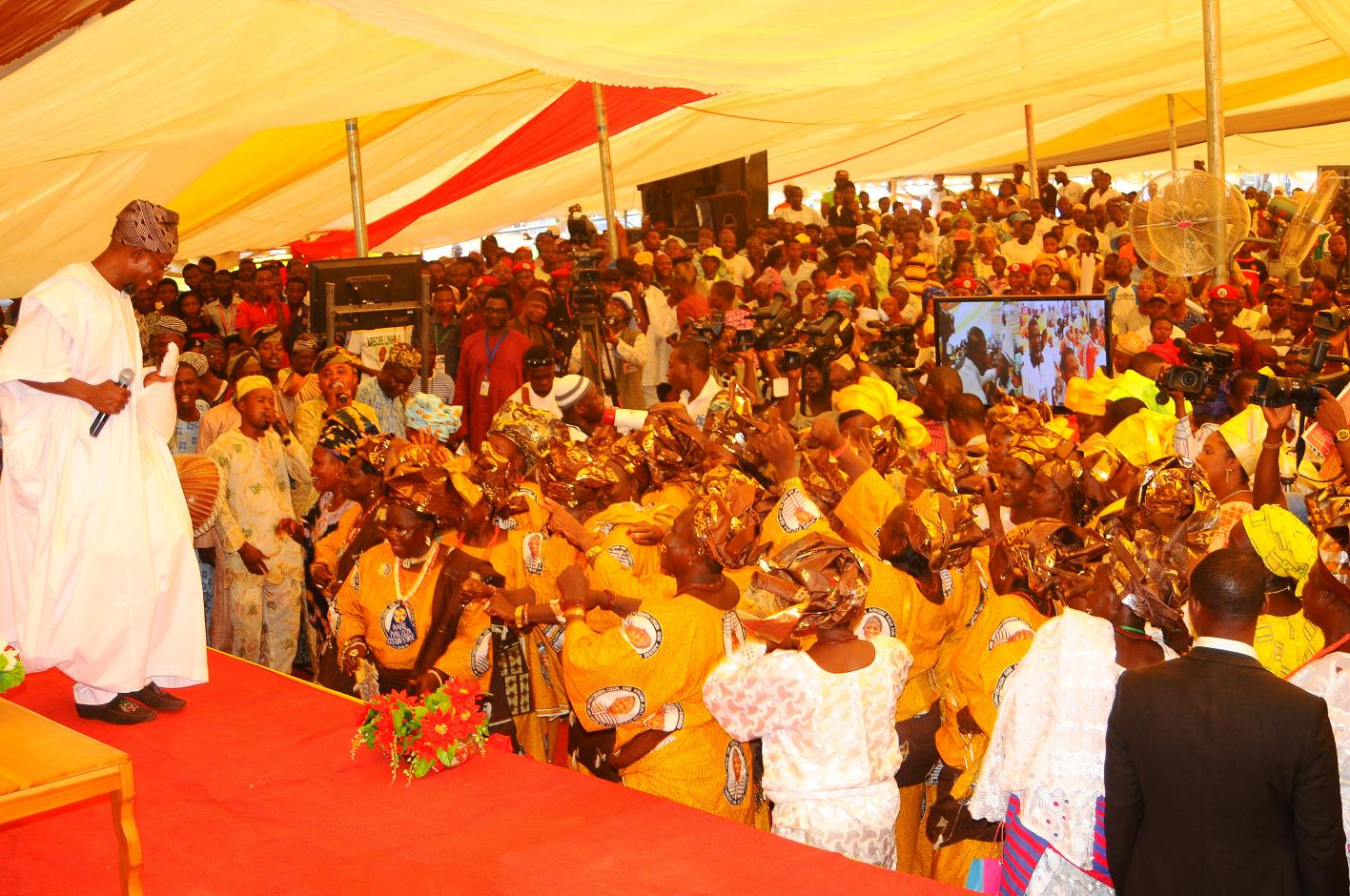 """Governor State of Osun, Ogbeni Rauf Aregbesola (left) dancing with the State  market women and People of Ijeshaland after their word of support for his Second Term in office, during the 6th edition of an interactive programme tagged, """"Gban-gba Dekun"""" in Ijesha South Federal Constituency consisting of Ilesa West, Ilesa East, Atakumosa East and Atakumosa West Local Governments at Ilesa High School, Ilesa, State of Osun last week"""