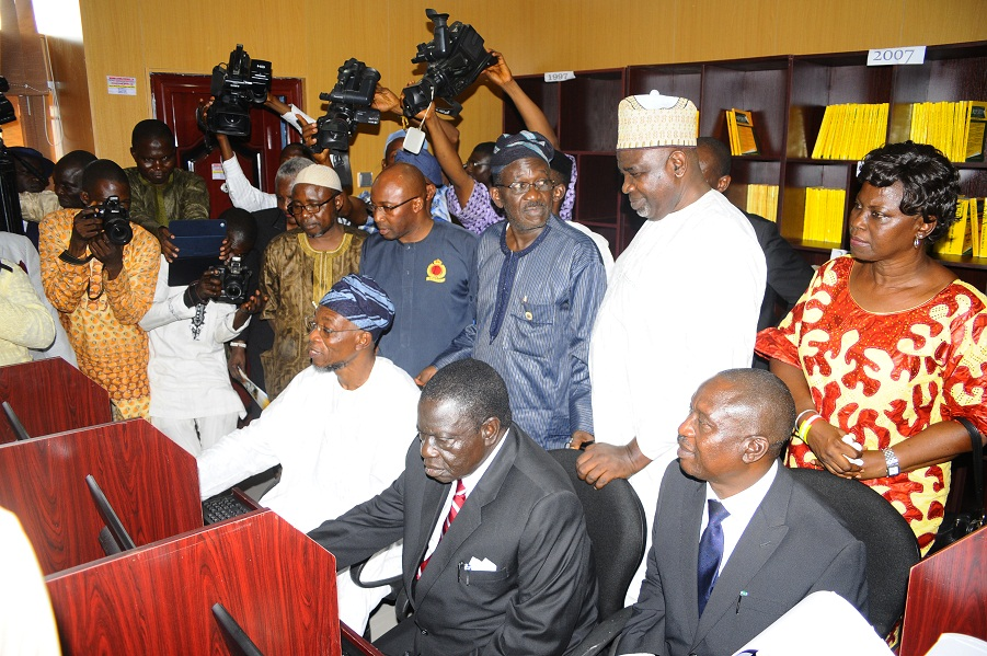 Governor State of Osun, Ogbeni Rauf Aregbesola (3rd left first row); Attorney General and Commissioner for Justice, Barrister Wale Afolabi (left first row); Justice Adebisi Ogunlade representing the State Chief Judge (2nd right first row) and others, at the Commissioning and Inspection of Sir Sapara Williams Law Library, in the Ministry of Justice, State Secretariat, Abere via Osogbo, State of Osun on Friday 29-11-2013