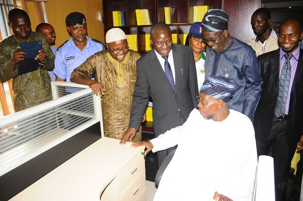 Governor State of Osun, Ogbeni Rauf Aregbesola (sitting); Attorney General and Commissioner for Justice, Barrister Wale Afolabi (4th left); Assistant Chief of Staff, Legal Matters, Barrister Gbenga Akano (3rd left); and others, during the Commissioning and Inspection of Sir Sapara Williams Law Library, in the Ministry of Justice, State Secretariat, Abere via Osogbo, State of Osun on Friday 29-11-2013