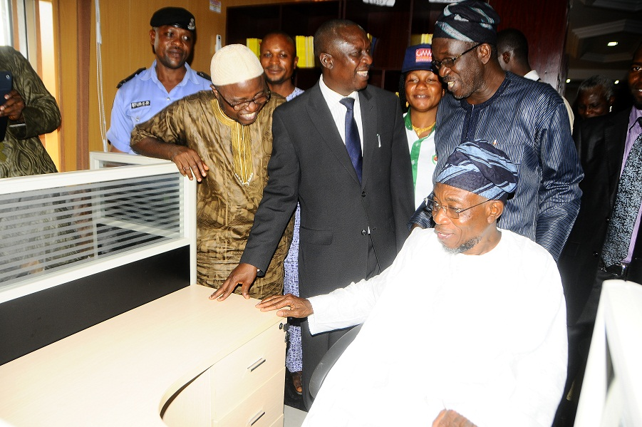 Governor State of Osun, Ogbeni Rauf Aregbesola (sitting); Attorney General and Commissioner for Justice, Barrister Wale Afolabi (3rd right); Assistant Chief of Staff, Legal Matters, Barrister Gbenga Akano (4th right); and others, during the Commissioning and Inspection of Sir Sapara Williams Law Library, in the Ministry of Justice, State Secretariat, Abere via Osogbo, State of Osun on Friday 29-11-2013