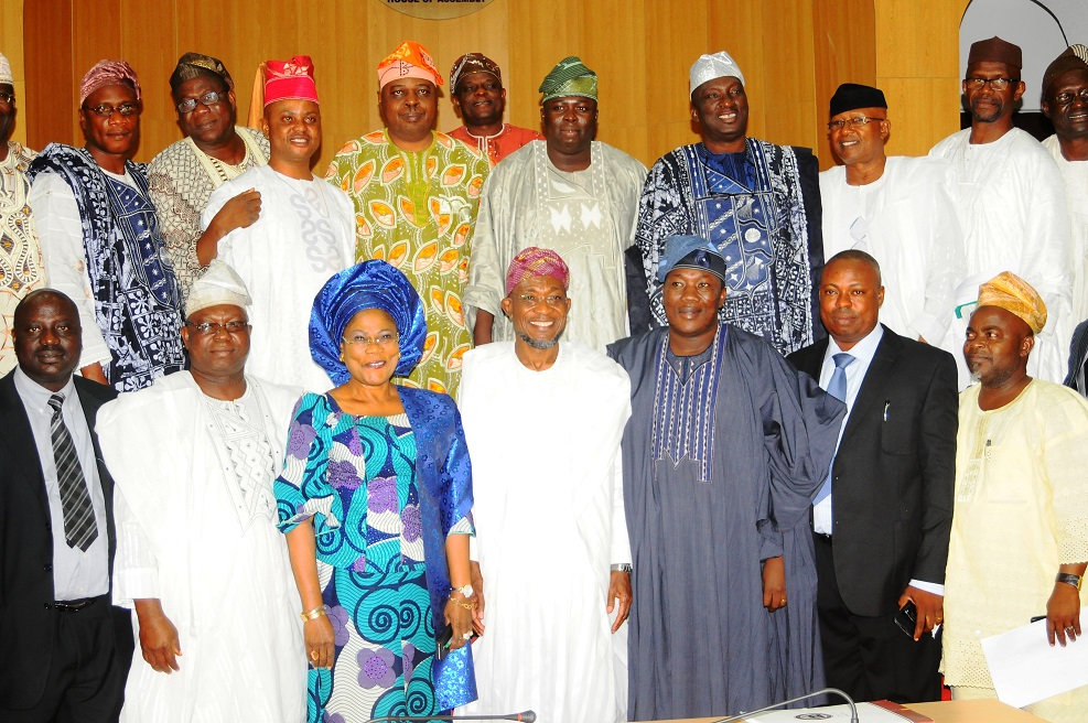 Governor State of Osun, Ogbeni Rauf Aregbesola (centre, 1st row); his Deputy, Mrs Titi Laoye-Tomori (3rd left, 1st row); Speaker, State House of Assembly of Osun, Honourable Najeem Salam (3rd right, 1st row); Deputy Speaker, Honourable Akintunde Adegboye (2nd left, 1st row); House Leader, Honourable Timothy Owoeye (2nd right, 1st row); Former Speaker of the House, Professor Mojeed Alabi (right, 1st row) and other members of the Legislative, during the Presenting of the Executive Bill on creation of additional 27 Local Governments,  at the Hallowed Chamber of the House, Osogbo, State of Osun on Monday 16-12-2013