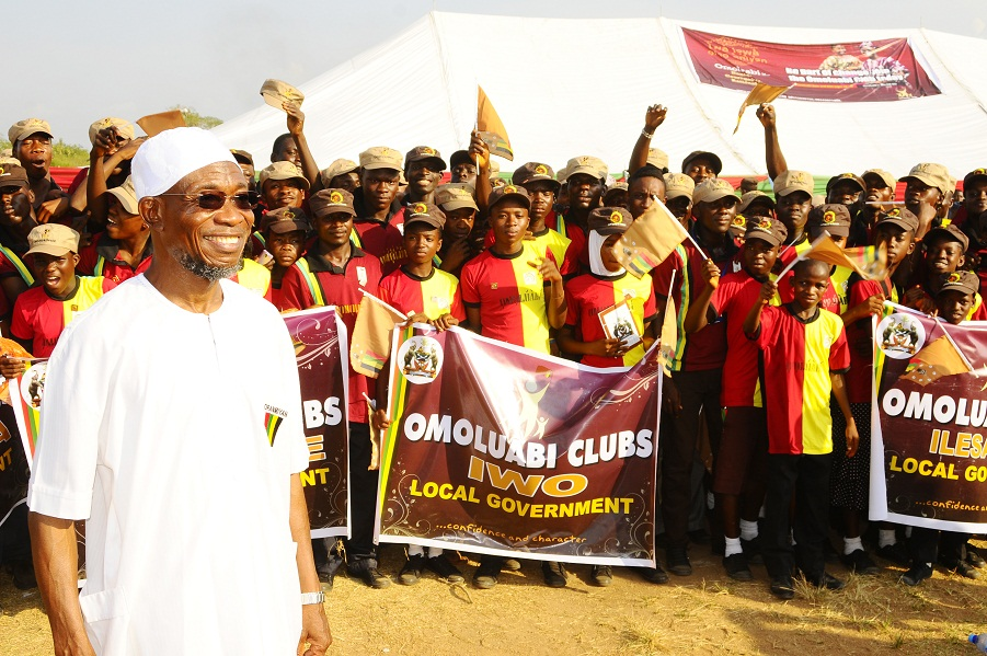 Governor State of Osun, Ogbeni Rauf Aregbesola (left) with the members of the newly Launched Omoluabi Boys/Girls Club and Omoluabi Youth Club, In commemoration of Aregbesola 3rd year Administration at the National Youth Service Corps ( NYSC)  Orientation Camp Ede, State of Osun at the weekend