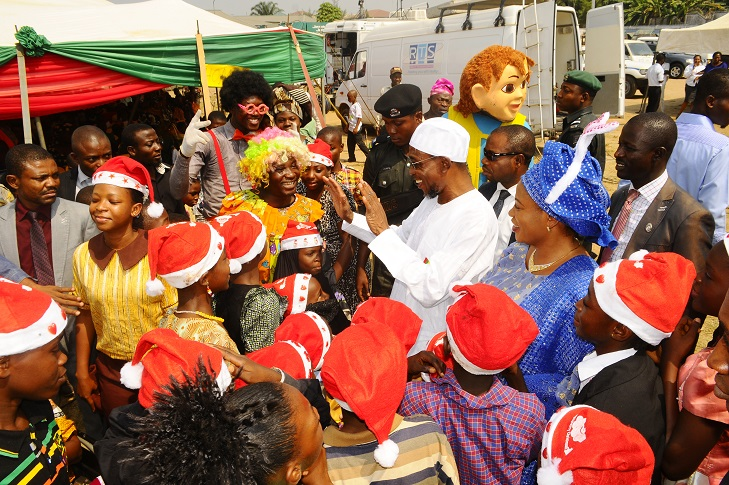 Governor State of Osun, Ogbeni Rauf Aregbesola and his wife, Sherifat, dancing with Childrens from the School for the Handicapped, during the Xmas/ End of the Year Party organised for the State Children by the Wife of the State Governor in collaboration with the  Ministry of Women and Children Affairs, at Government House Lawn, Osogbo, State of Osun on Monday 23-12-2013