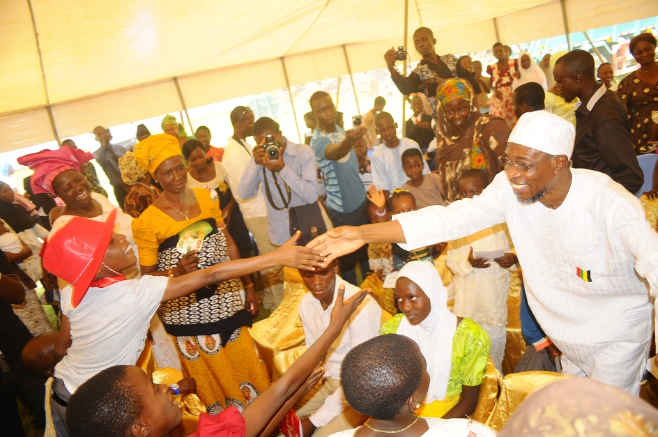 Governor State of Osun, Ogbeni Rauf Aregbesola acknowledging cheers from Enthusiastic Children,  during the Xmas/ End of the Year Party organised for the State Children by the Wife of the State Governor in collaboration with the  Ministry of Women and Children Affairs, at Government House Lawn, Osogbo, State of Osun on Monday 23-12-2013