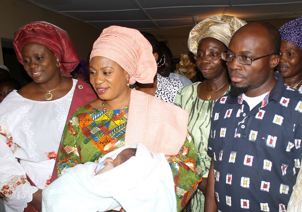 Wife of the Governor, State of Osun, Alhaja Sherifat Aregbesola (2nd left); Commissioner for Health, Mrs Temitope Ilori (left); Permanent Secretary, Hospitals Management Board, Pharmacist Omolara Ajayi (2nd right); Special Adviser to the Governor on Health, Dr. Rafiu Isamotu (right) and others, during her donation of gifts to the First Baby of the Year born at 12.01am, at Primary Health Care Centre, Iwo, State of Osun on Wednesday 01-01-2014