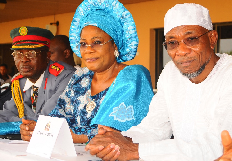 From right, Governor State of Osun, Ogbeni Rauf Aregbesola; his Deputy, Mrs Titi Laoye-Tomori and Deputy Commandant and Chairman, Nigerian Legion Osun Chapter, Colonel Alimi Samotu, during the Launching of Emblem for Year 2014 Armed Forces Remembrance Day Celebration and Fund Raising Appeal Week at Government House, Osogbo, State of Osun on Thursday 09-01-2014