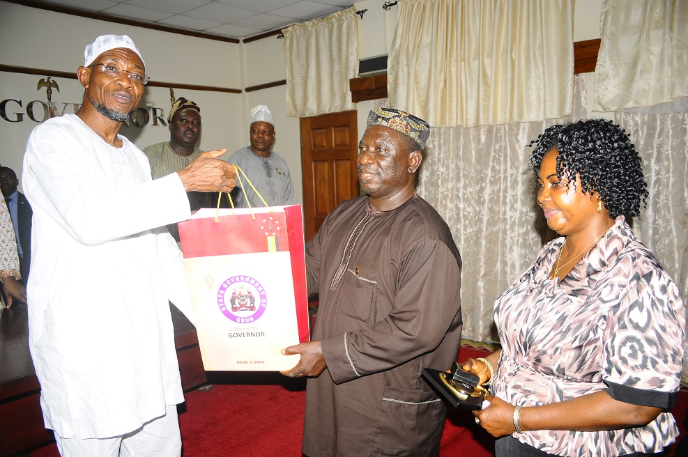 From left, Governor State of Osun, Ogbeni Rauf Aregbesola; State Director, National Orientation Agency (NOA), Mr Remi Omowon and Deputy Director of the Agency, Mrs Yomi Olasinde, during the New State Director of the Agency's Courtesy Visit and Investiture of the Governor as Patron of Community Support Brigade (CSB) at the Governor's office, Osogbo, State of Osun