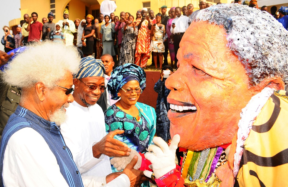 From left, Nobel Laureate, Professor Wole Soyinka; Governor State of Osun, Ogbeni Rauf Aregbesola; his Deputy, Mrs Titi Laoye-Tomori and Mandela Masqurade (Egungun Mandela), during the Centre for Black Culture and International Understandings 2014 Take-Off activities and unveiling of the World Tallest Drum in Osogbo, State of Osun on Wednesday 15-01-2014