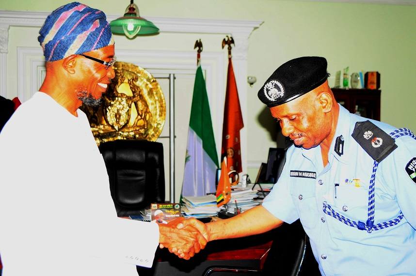 Governor State of Osun, Ogbeni Rauf Aregbesola  with newly posted Commissioner of Police to the State, Mr. Ibrahim Maishanu, during a visit to the Governor in his office, Abere, Osogbo, State of Osun on Tuesday 11/02/2014.