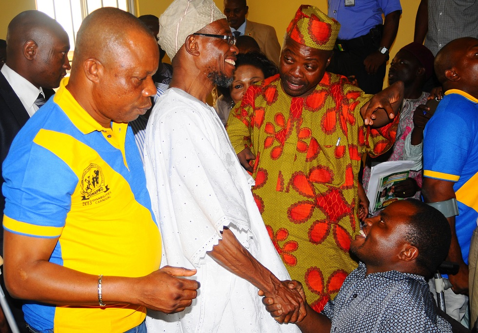 Governor State of Osun, Ogbeni Rauf Aregbesola (2nd left) celebrates with disables during the declaration their  Supports for his Second Term in office, at Local Government Civil Service Commission hall, Osogbo, State of Osun. With him are, Special Adviser to the Governor on Youths, Sports and Special Needs, Comrade Biyi Odunlade (left); Special Adviser to Oyo State Governor on Special People, Prince Paul Adelabu (3rd right); Chairman, Joint National Association of Persons with Disabilities (JONAPWD), Osun Chapter, Mr Onitiju Kehinde (2nd right) and others