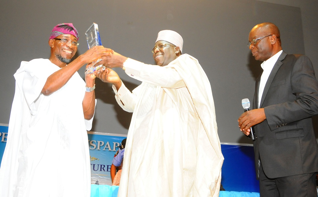 From left, Governor State of Osun, Ogbeni Rauf Aregbesola; Chairman of the occasion, Alhaji Gambo Lawan and Managing Director, Independent Newspaper Limited (INL), Mr Ted Iwere, during the Governor's Investiture as the 2013 Man of the Year, at Eko Hotel and Suites, Lagos on Friday 21-02-2014