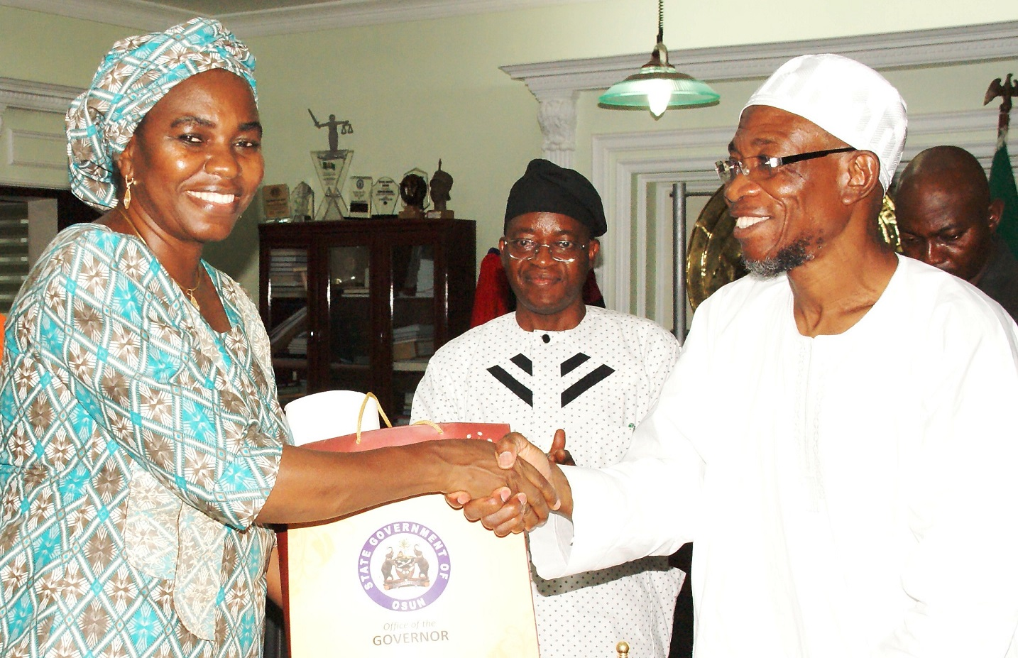 From left, Governor State of Osun, Ogbeni Rauf Aregbesola; Chief of Staff, Alhaji Gboyega Oyetola and Minister for Water Resources, Mrs Sarah Ochekpe, during a Courtesy Visit to the Governor in his Office, Osogbo, State of Osun last Thursday