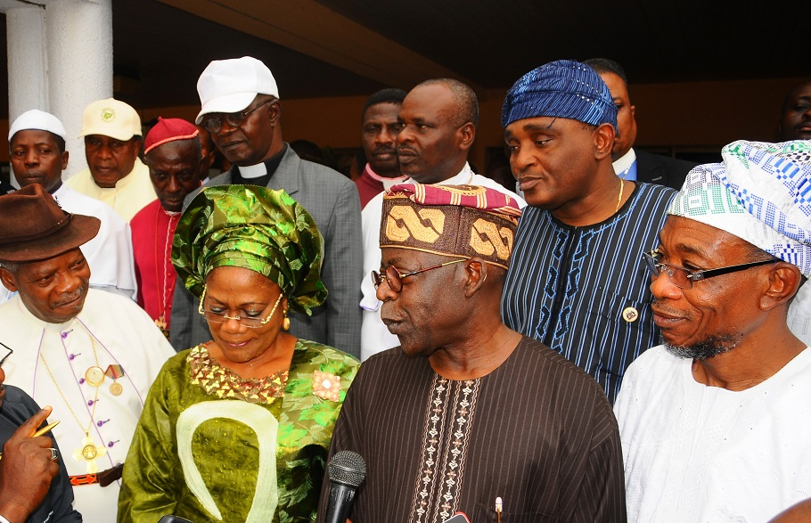 National Leader, All Progressives Congress (APC), Asiwaju Bola Ahmed Tinubu (2nd right); Governor State of Osun, Ogbeni Rauf Aregbesola (right); his Deputy, Mrs Titi Laoye-Tomori; Christian Association of Nigeria (CAN) South West Chairman, Bishop Magnus Atilade (left); Former Osun CAN Chairman, Evangelist Abraham Aladeseye (middle 2nd row); Director General, Bureau of Social Services (BOSS), Mr Femi Ifaturoti (2nd row-right) and other Bishops, during the APC National Leader's Peace Meeting with South West CAN in Osogbo, State of Osun on Wednesday 12-02-2014