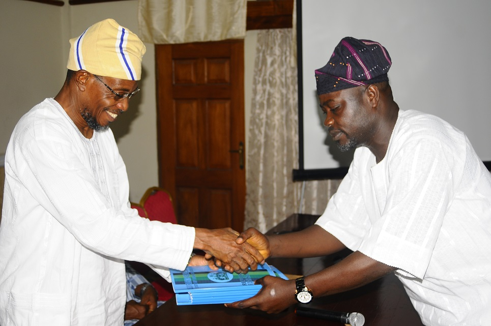Governor State of Osun, Ogbeni Rauf Aregbesola, receiving Report on the 2013 Hajj Operation from Commissioner for Home affairs, Culture and Tourism, Honourable Sikiru Ayedun at the Office of the Governor, Abere, State of Osun on Wednesday 19-03-2014