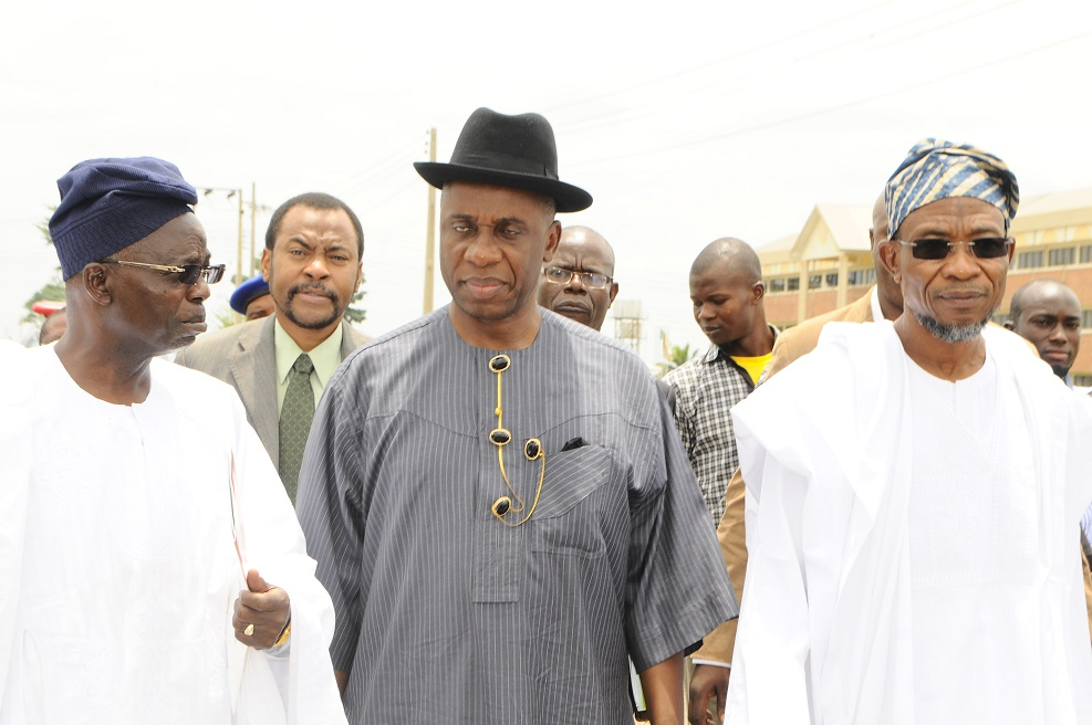 Governor, State of Osun,Ogbeni Rauf Aregbesola (right); Distinguished Guest Lecturer, River State Governor, Hon.  Rotimi Amaechi (middle) and Pro-Chancellor and Chairman of Council Osun State University, Osogbo, Professor Gabriel Adesiyan Olawoyin(left) at the 2nd UNIOSUN Distinguished Guest lecture, held at the University Auditorium Main Campus Osogbo, State of Osun on Wednesday 26/03/2014.