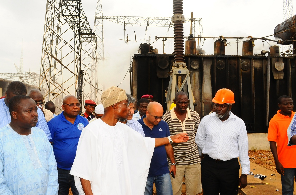 From left, Special Adviser to the Governor on Security Matters, Barrister Adekunle Amos; Governor State of Osun, Ogbeni Rauf Aregbesola; Executive Director of Transmission, TCN, Mr Shahid Mohamad; Executive Director of Operations, TCN, Dipak Sarma; Principal Manager of Transmission, TCN, Engineer Ade Odukale; Assistant General Manager of Transmission, Transmission Company of Nigeria (TCN), Engineer Niyi Oladele and others, during the Governor's assessment of the fire outbreak at the TCN Osogbo Sub-Region 330/132/33kv Substation in Osogbo, State of Osun on Friday 07-03-2014