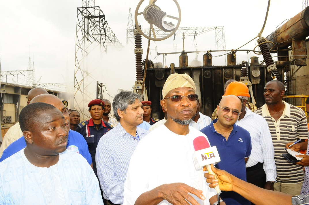 From left, Special Adviser to the Governor on Security Matters, Barrister Adekunle Amos; Executive Director of Transmission, TCN, Mr Shahid Mohamad; Governor State of Osun, Ogbeni Rauf Aregbesola; Executive Director of Operations, TCN, Dipak Sarma; Principal Manager of Transmission, TCN, Engineer Ade Odukale; Assistant General Manager of Transmission, Transmission Company of Nigeria (TCN), Engineer Niyi Oladele and others, during the Governor's assessment of the fire outbreak at the TCN Osogbo Sub-Region 330/132/33kv Substation in Osogbo, State of Osun on Friday 07-03-2014