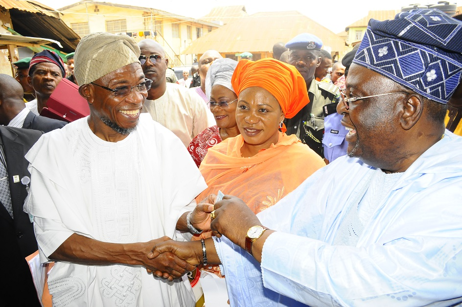 From left, Governor State of Osun, Ogbeni Rauf Aregbesola; his wife, Sherifat; Chairman, Resident Electoral Commissioner, Ambassador Rufus Akeju and others, during the collection of their Permanent Voter cards at Ward 8, Ilesa East Local Government, Ilesa, State of Osun on Friday 07-03-2014