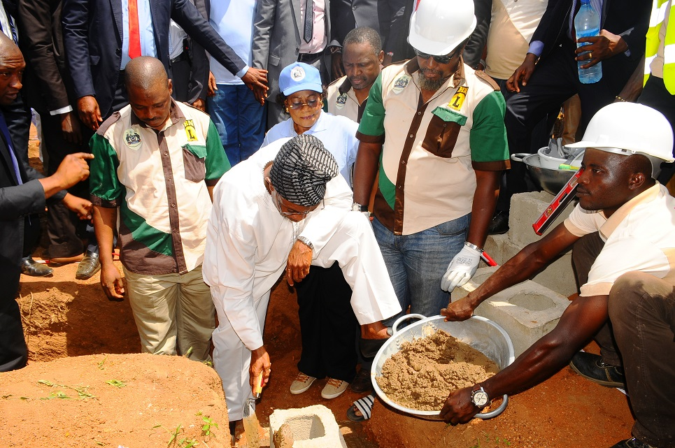 Governor State of Osun, Ogbeni Rauf Aregbesola (2nd left) laying foundation for the Construction of an Ultra Modern Central Abattoir in Osogbo, State of Osun on Wednesday 15-04-2014. With him are, his Deputy, Mrs Titi Laoye-Tomori (3rd left); Commissioner for Agriculture and Food Security, Mr Wale Adedoyin (4th left); Managing Director, Hanfriqul Nigeria Limited, Alhaji Kolawole Aresa (left); Sub-Consultant, Hanfriqul Nigeria Limited, Mr Dapo Ademosu (5th left) and others.
