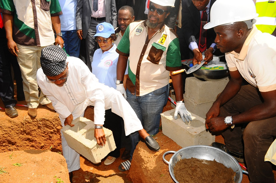 Governor State of Osun, Ogbeni Rauf Aregbesola (left) laying foundation for the Construction of an Ultra Modern Central Abattoir in Osogbo, State of Osun on Wednesday 15-04-2014. With him are, his Deputy, Mrs Titi Laoye-Tomori (2nd left); Commissioner for Agriculture and Food Security, Mr Wale Adedoyin (3rd left); Sub-Consultant, Hanfriqul Nigeria Limited, Mr Dapo Ademosu (4th left) and others.