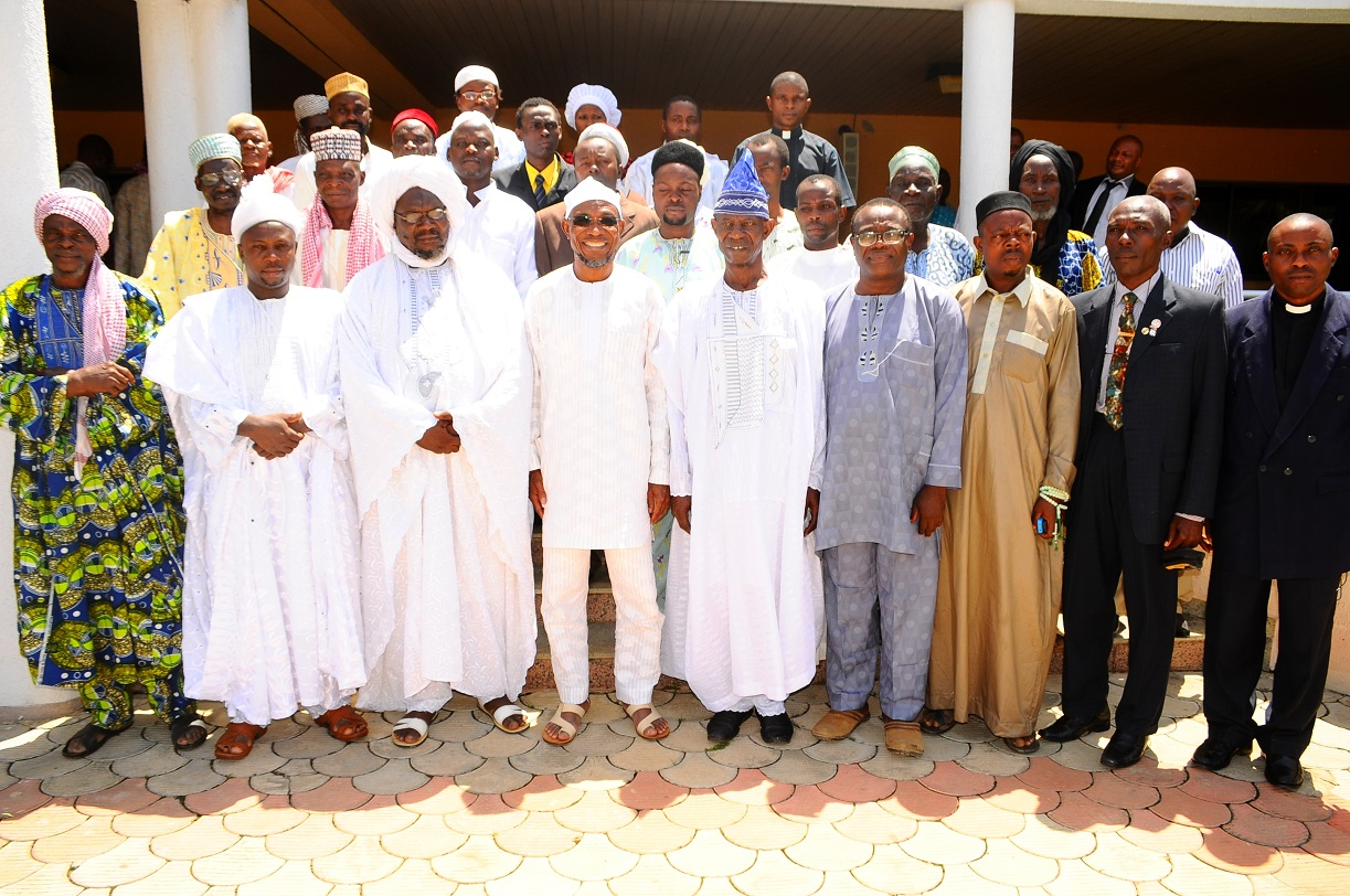 Governor State of Osun, Ogbeni Rauf Aregbesola (4th left); Chairman, Christian Association of Nigeria (CAN) Ife South Local Government Area, Pastor John Oladimeji (5th right); President, League of Imams and Alfas, Ife South LGA, Alhaji Soliu Alesinloye (3rd left); Coordinator, Quick Impact Intervention Project (QIIP), Mr Dele Ogundipe (4th right); Chief Imam, Mefoworade Ife South LGA, Alhaji Lukman Arowolo (2nd left); Reverend Wale Olanrewaju (2nd right); Chief Imam Isale-Ife, Ife South, Mallam Azeez Sikirullahi (3rd right) and others, during a Solidarity Visit by Muslimss and Christians Leaders in Ife South Local Government areas to the Governor in Osogbo, State of Osun on Thursday 10-04-2014