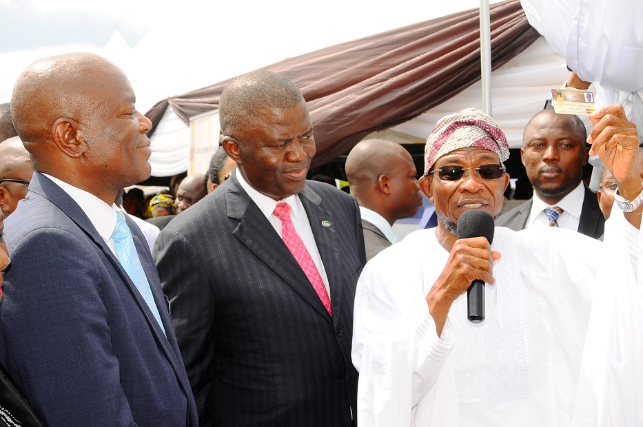 From right, Governor State of Osun, Ogbeni Rauf Aregbesola; General Managing Director, Charms Plc, Sir Demola Aladekomo and First Bank Plc representative, Mr Timothy Arowoogun, during the State of Osun Civil Servant Smart ID Card and Biometric Automation of 'I am alive' at Office of the Governor Parking lot, State Secretariat, Osogbo, State of Osun on Tuesday 29-04-2014.