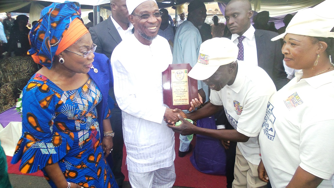 From left, Deputy Governor, State of Osun, Mrs Titi Laoye-Tomori; Governor Rauf Aregbesola; President, Nigeria Union of Tailor, Osun State Chapter, Alhaji Kasali Akinloye and Vice Lady President,  Mrs Oluwatoyin Abiola Alabi,  during the conferment of life Patron on the governor/endorsement of his 2nd term in office by Nigeria Union of Tailor in Osogbo on Tuesday 08-04-2014
