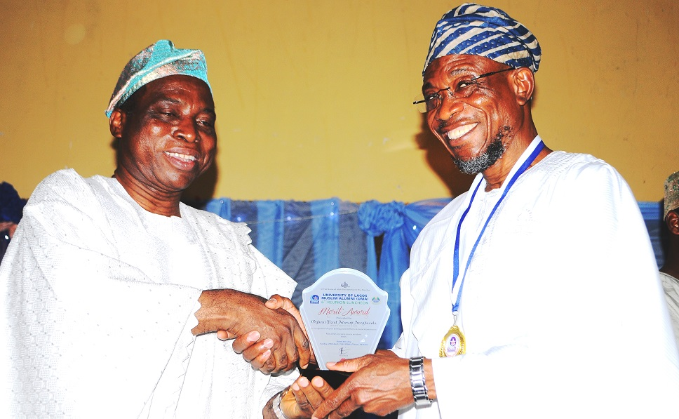 From left –* Vice Chancellor, University of Lagos, Professor Rahaman Adisa Bello Presenting an Award to the Governor of the State of Osun, Ogbeni Rauf Aregbesola in Recognition of his Distinguished Efforts at Good Governance, during the 6th Reunion Luncheon at Eko Hotel &Suites, Victoria Island, Lagos on Sunday 20-04-2014.